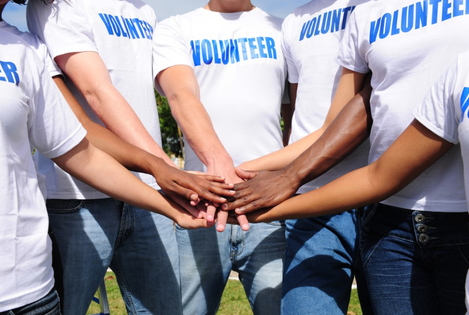 Volunteers-Hands-Together-Image-960×645