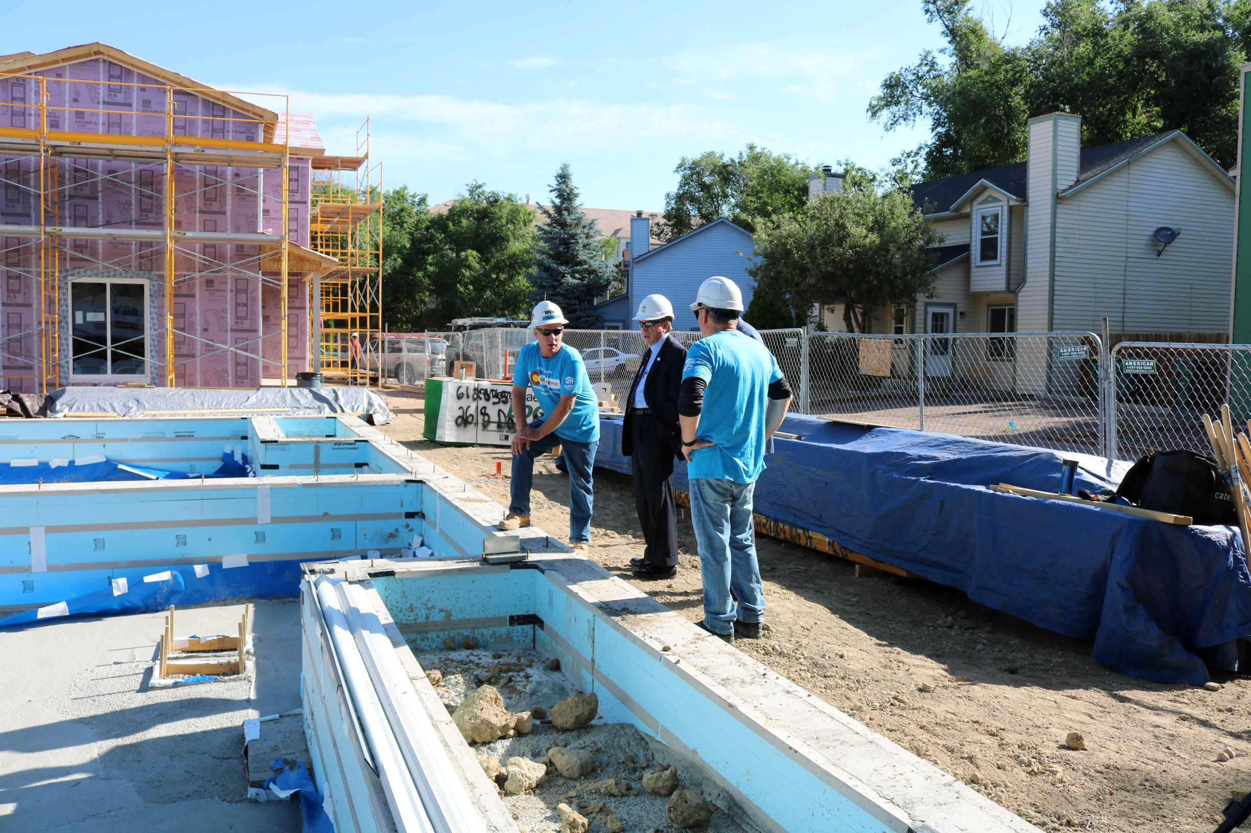 Trevor Bennett Conducts a Tour of the Construction Site.