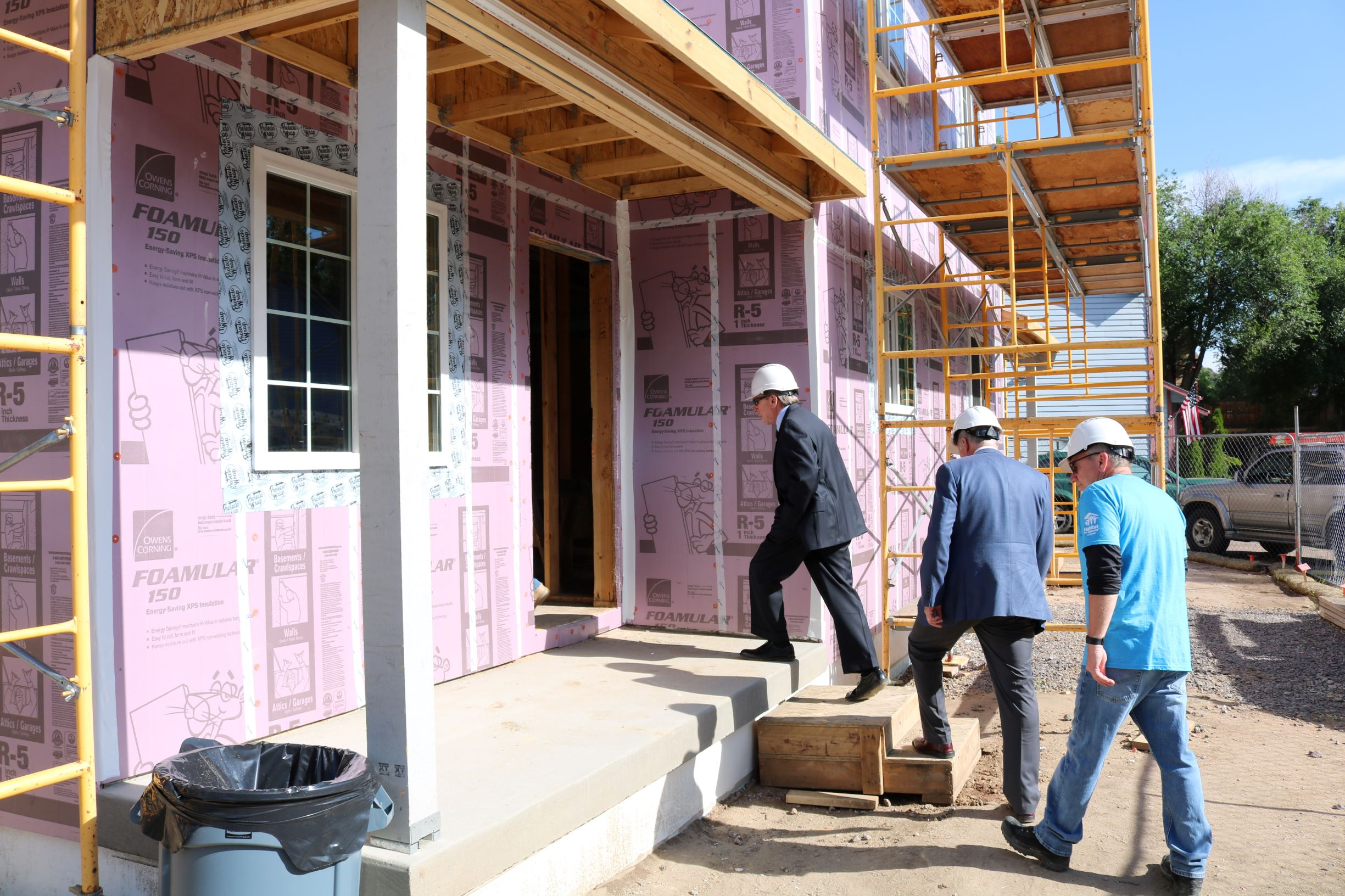 Mayor Suthers, Steve Posey, Community Development Division Manager for the City of COS, and Greg Kovach, Director of Operations at PPHFH enter a current build.