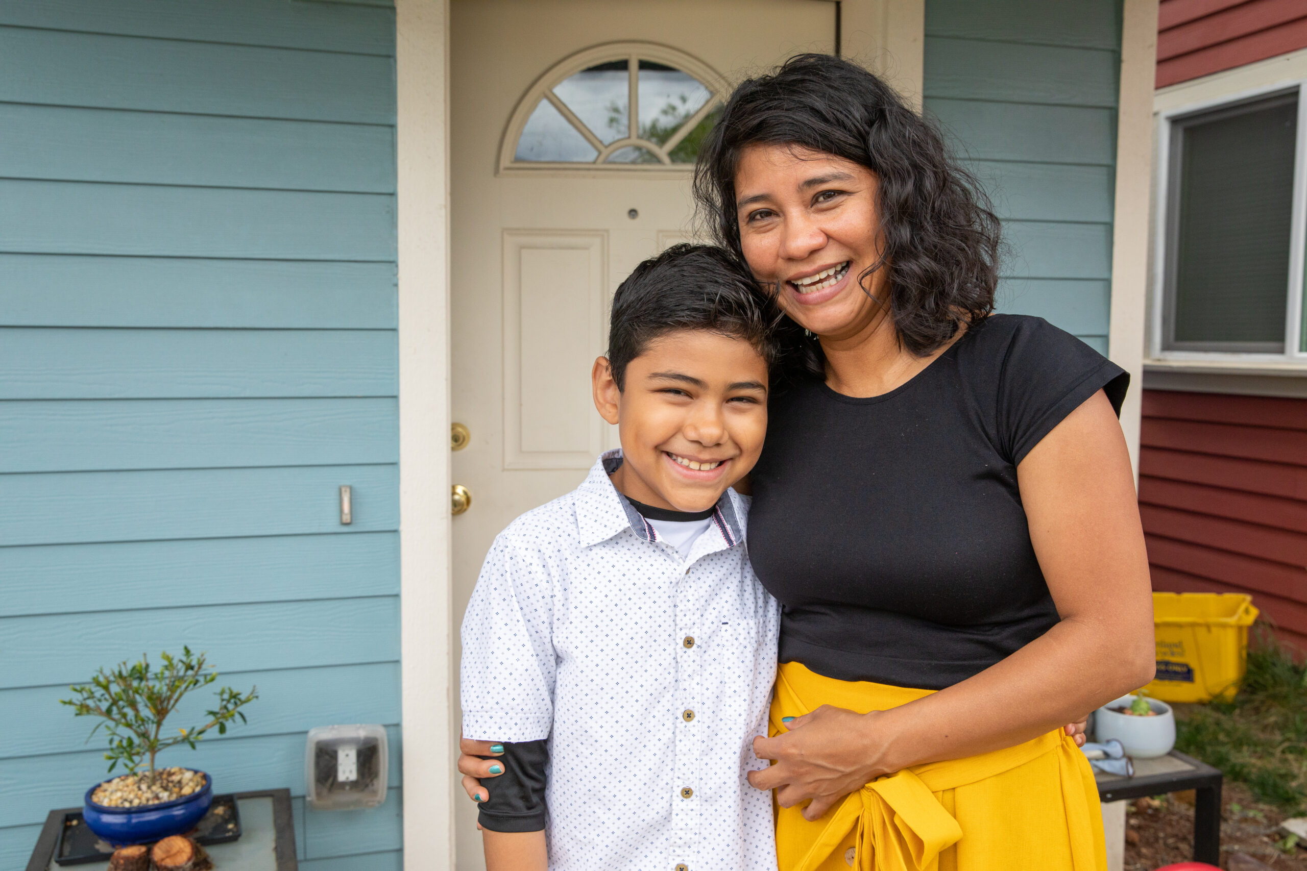 PORTLAND, OREGON (07/26/2019)-Lizet Molina Neri and her son, Alan (9), in front of the Habitat home that she helped build. ©Habitat for Humanity International/Jason Asteros